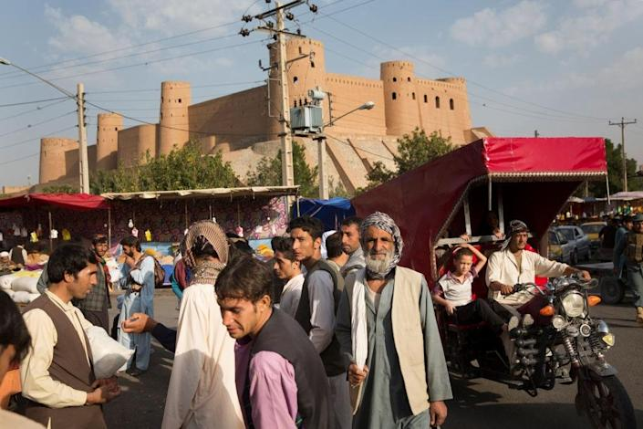 Street life in front of the Herat's ancient citadel, which was restored by the Aga Khan Trust for Culture.