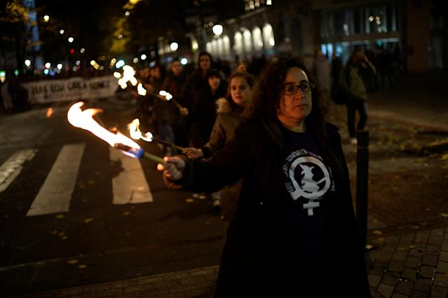 "<p>Protesters carry torches and walk behind a banner reading ""Your truth is Ours. Our Word Counts"" during a demonstration on the World Day for the Elimination of Violence against Women in Bilbao, northern Spain, Nov. 25, 2017. (Photo: Vincent West/Reuters) </p>"