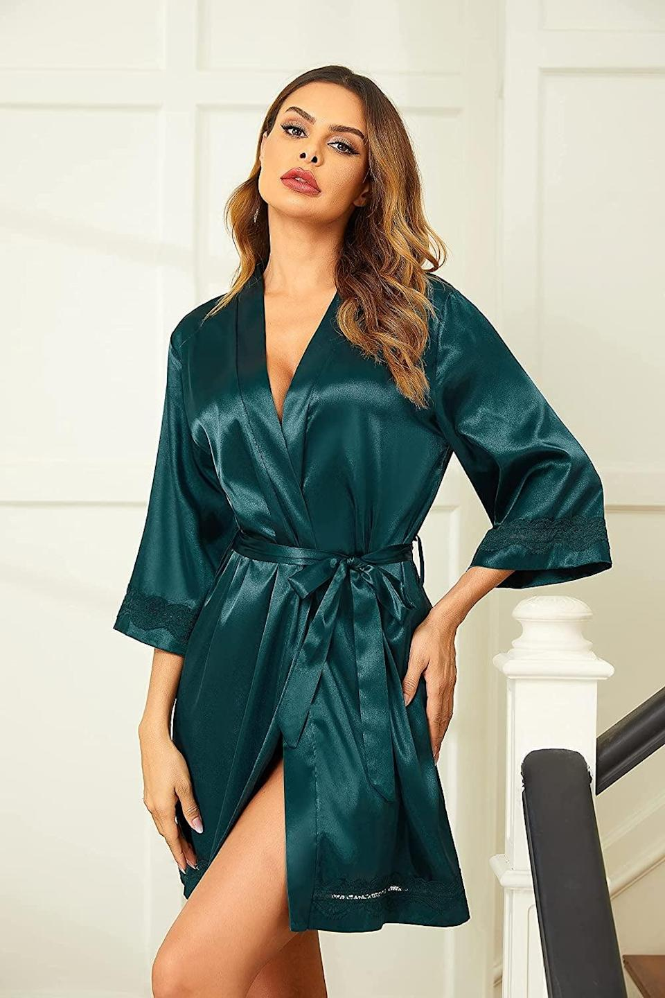 <p>If they're all about that fabulous, luxurious vibe, they'll obsess over this <span>Ekouaer Women's Lace-Trim Kimono Style Short Satin Robe Sleepwear</span> ($26). It will make them feel like royalty. Plus, it comes in a ton of different colors and patterns so you can choose their favorite color.</p>