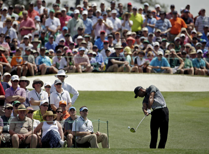 Tiger Woods tees off on the third hole during the third round of the Masters golf tournament Saturday, April 11, 2015, in Augusta, Ga. (AP Photo/Charlie Riedel)