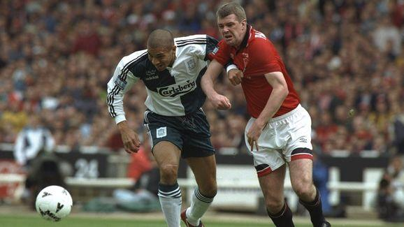 Stan Collymore of Liverpool and Gary Pallister of Manchester United