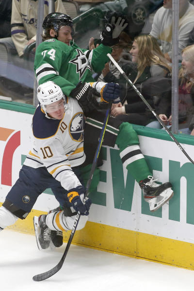 Buffalo Sabres defenseman Henri Jokiharju, left, rides Dallas Stars left wing Roope Hintz, right, up the boards during the second period of an NHL hockey game in Dallas, Thursday, Jan. 16, 2020. (AP Photo/Ray Carlin)