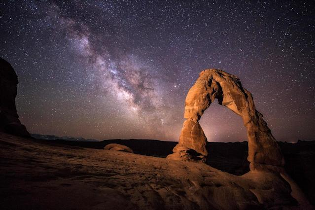 <p>A professional photographer captured these amazing images of the night sky under sandstone archways in the desert. (Photo: Brad Goldpaint/Caters News) </p>