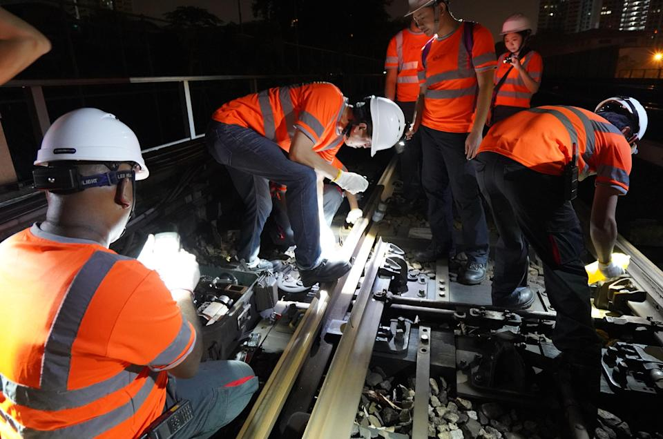SMRT Group CEO Neo Kian Hong (second from left) observing signalling maintenance works in October 2018. PHOTO: SMRT