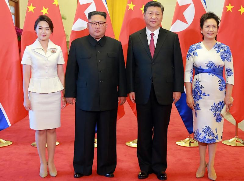 The first ladies of North Korea and China joined their husbands Kim Jong Un and Xi Jinping at the gathering in Beijing (AFP Photo/-)