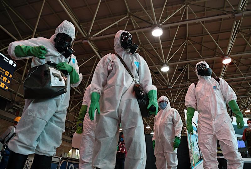 Picture of Navy soldiers at Tom Jobim Galeao International Airport in Rio de Janeiro, Brazil, preparing to carry out a disinfection operation against the novel coronavirus COVID-19