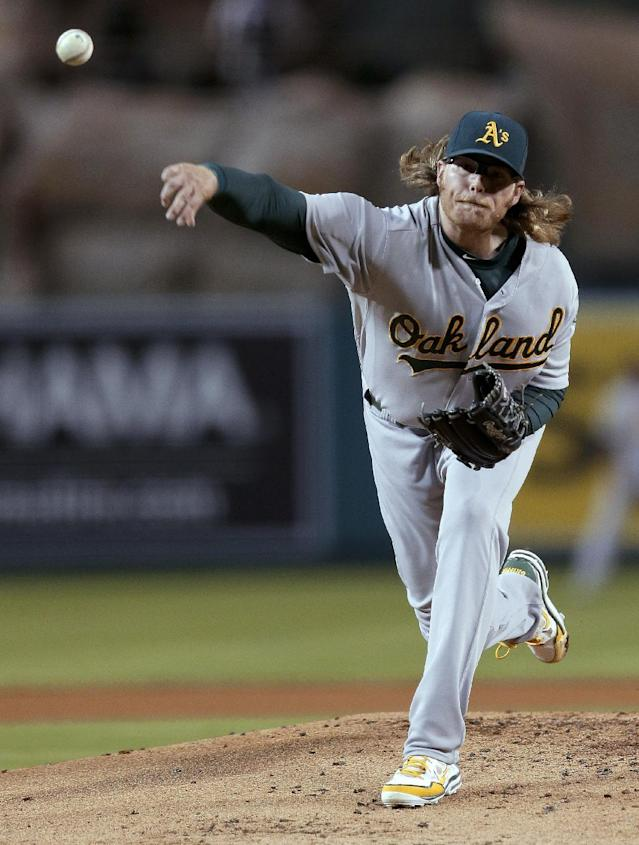 Oakland Athletics starting pitcher A.J. Griffin throws to a Los Angeles Angels batter during the first inning of a baseball game in Anaheim, Calif., Tuesday, Sept. 24, 2013. (AP Photo/Chris Carlson)