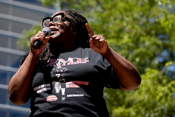 Hannah Drake recites spoke word Sunday, May 31, 2020, during a Black Lives Matter healing rally in front of KFC Yum! Center in downtown Louisville.