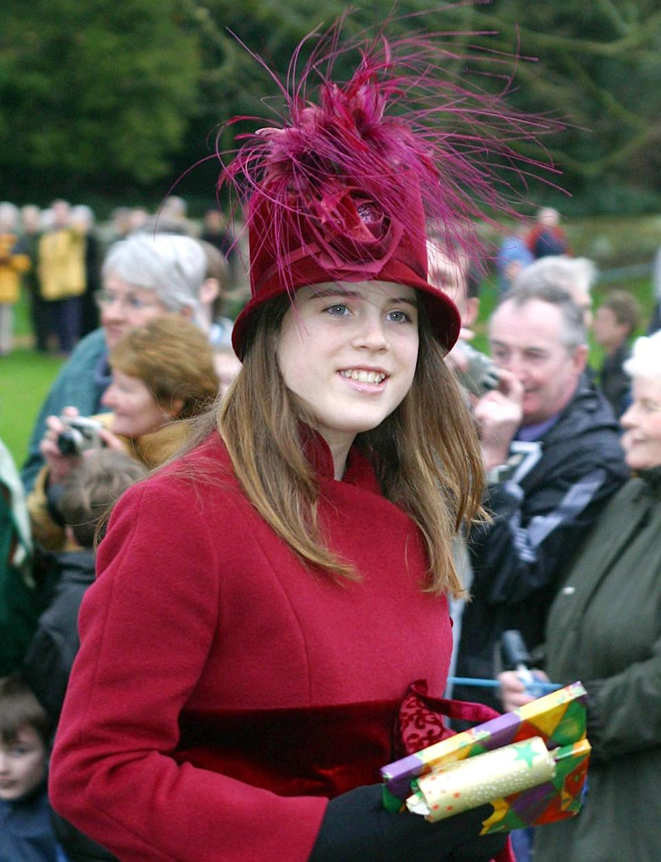 <p>Eugenie continues to display her penchant for high-key headgear.</p>