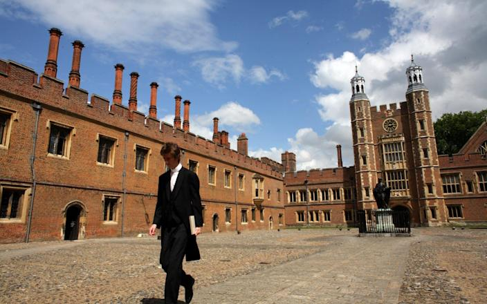 WINDSOR, UNITED KINGDOM - JUNE 2007: An Eton College pupil walks thorough School Yard with Luptons Tower in the background at Eton College, the iconic English private school, Eton College. Eton College was founded in 1440 by King Henry VI. The College originally had 70 King's Scholars or 'Collegers' who lived in the College and were educated free, and a small number of 'Oppidans' who lived in the town of Eton and paid for their education. Eton has a very long list of distinguished former pupils, including eighteen former British Prime Ministers. - Christopher Furlong/Getty Images