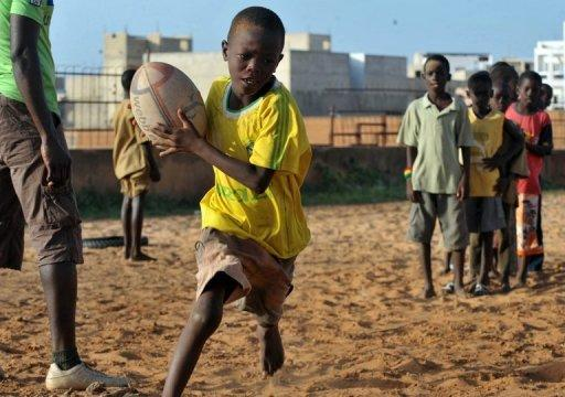 Every day, children in a northern neighborhood of the capital Dakar come to play ball in the House of Rugby, a centre launched two years ago as the sport gains ground in this football-loving nation
