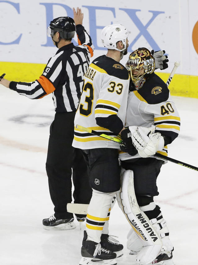 Boston Bruins' Zdeno Chara (33), of Slovakia, hugs goalie Tuukka Rask (40), of Finland, following Game 3 of the NHL hockey Stanley Cup Eastern Conference final series against the Carolina Hurricanes in Raleigh, N.C., Tuesday, May 14, 2019. Boston won 2-1. (AP Photo/Gerry Broome)