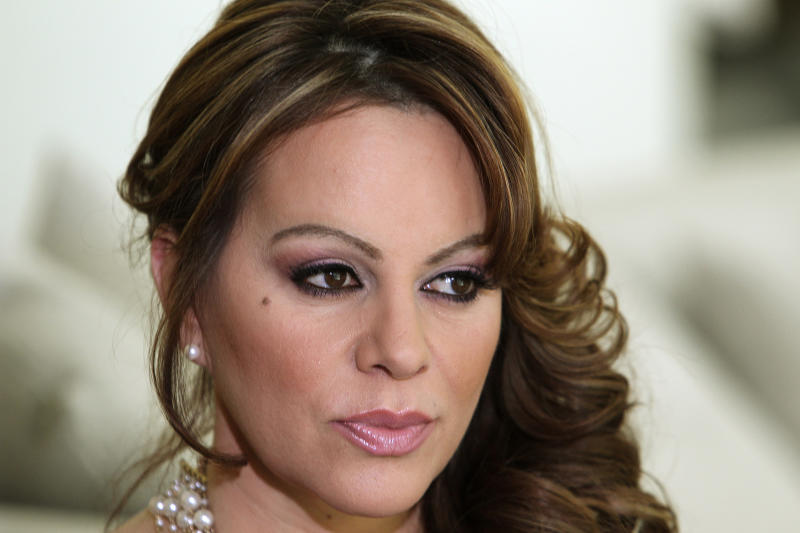 FILE - In this March 8, 2012 file photo, Mexican-American singer and reality TV star Jenni Rivera poses during an interview in Los Angeles. Las Vegas-based Starwood Management, the company that owns the luxury jet that crashed and killed Rivera on Dec. 9, is under investigation by the U.S. Drug Enforcement Administration, and the agency seized two of its planes earlier this year as part of the ongoing probe. (AP Photo/Reed Saxon, File)