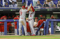 Los Angeles Angels' Jose Iglesias (4) congratulates Mike Trout after his solo home run against the Toronto Blue Jays during the fifth inning of a baseball game Thursday, April 8, 2021, in Dunedin, Fla. (AP Photo/Mike Carlson)