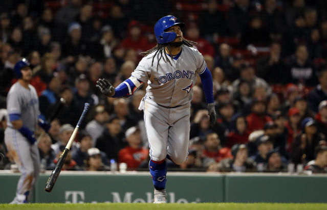 Toronto Blue Jays' Freddy Galvis tosses his bat as he watches his solo home run against the Boston Red Sox during the eighth inning of a baseball game Thursday, April 11, 2019, at Fenway Park in Boston. (AP Photo/Winslow Townson)