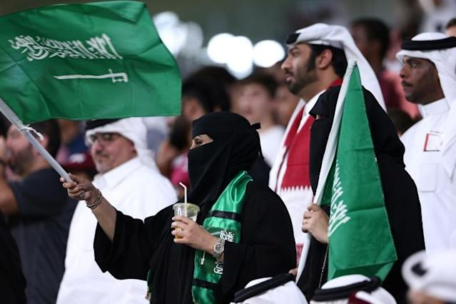Vocal minority: Saudi supporters wave their national flag as their team defeat Qatar in the Gulf Cup semi-finals (AFP Photo/MUSTAFA ABUMUNES)