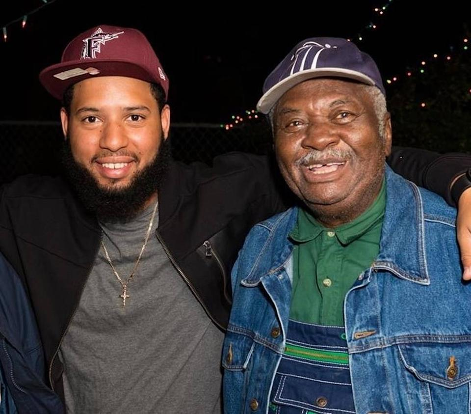 """Alex Yanes, left, followed in the footsteps of his grandfather, Lerue Sarvis, right, by becoming a longshoreman. Known as """"Overtown Fishman Lee,"""" Sarvis worked as a longshoreman at PortMiami for several decades."""