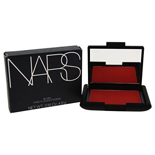 """<p><strong>NARS</strong></p><p>amazon.com</p><p><strong>$24.34</strong></p><p><a href=""""https://www.amazon.com/dp/B000PSQWAO?tag=syn-yahoo-20&ascsubtag=%5Bartid%7C10055.g.35821694%5Bsrc%7Cyahoo-us"""" rel=""""nofollow noopener"""" target=""""_blank"""" data-ylk=""""slk:Shop Now"""" class=""""link rapid-noclick-resp"""">Shop Now</a></p><p>One favorite of Crimson's is this NARS blush. """"I like to scrape a bit of it mixed into a few drops of <a href=""""https://b3balm.com/products/lillie-luxury-facial-oil"""" rel=""""nofollow noopener"""" target=""""_blank"""" data-ylk=""""slk:B3's Lillie Oil"""" class=""""link rapid-noclick-resp"""">B3's Lillie Oil</a> and press it into the skin with the lower palm of the hand or the large end of a beauty blender,"""" he says. Applying your blush this way gives you more of a dewy look. This <strong>fiery red</strong> is highly pigmented and shows up vibrantly on rich complexions. </p>"""