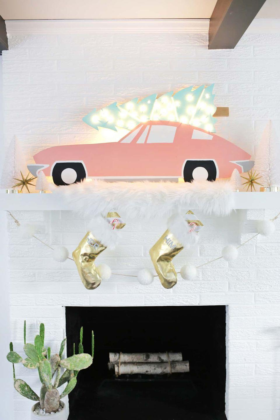 "<p>For a playful touch that's truly unique, create your very own retro marquee featuring a pink sports car carrying a lit Christmas tree. Complete the look with a sheepskin blanket, a pom-pom garland, and metallic accessories. </p><p><em>Get the tutorial at <a href=""https://abeautifulmess.com/vintage-car-christmas-tree-marquee/"" rel=""nofollow noopener"" target=""_blank"" data-ylk=""slk:A Beautiful Mess"" class=""link rapid-noclick-resp"">A Beautiful Mess</a>.</em></p><p><a class=""link rapid-noclick-resp"" href=""https://www.amazon.com/Prextex-Christmas-Clear-White-Decorations/dp/B075MNL1RW?tag=syn-yahoo-20&ascsubtag=%5Bartid%7C10072.g.34484299%5Bsrc%7Cyahoo-us"" rel=""nofollow noopener"" target=""_blank"" data-ylk=""slk:SHOP STRING LIGHTS"">SHOP STRING LIGHTS</a></p>"