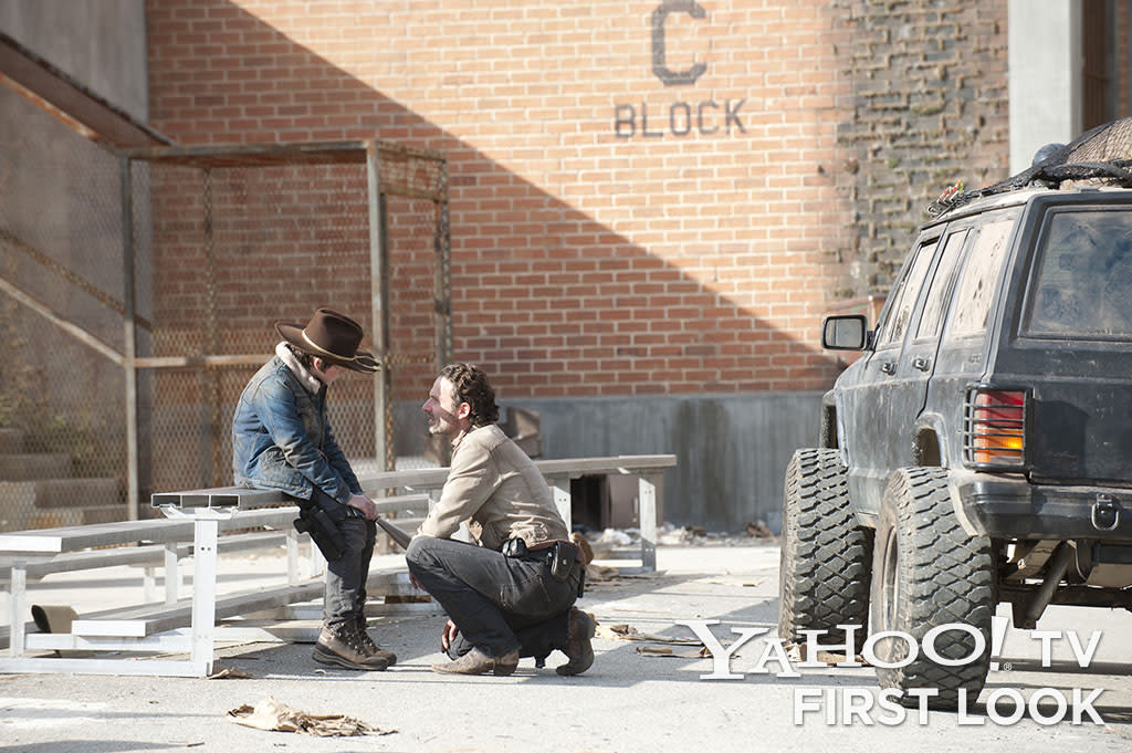 "Carl Grimes (Chandler Riggs) and Rick Grimes (Andrew Lincoln) in ""The Walking Dead"" episode, ""Welcome to the Tombs."""