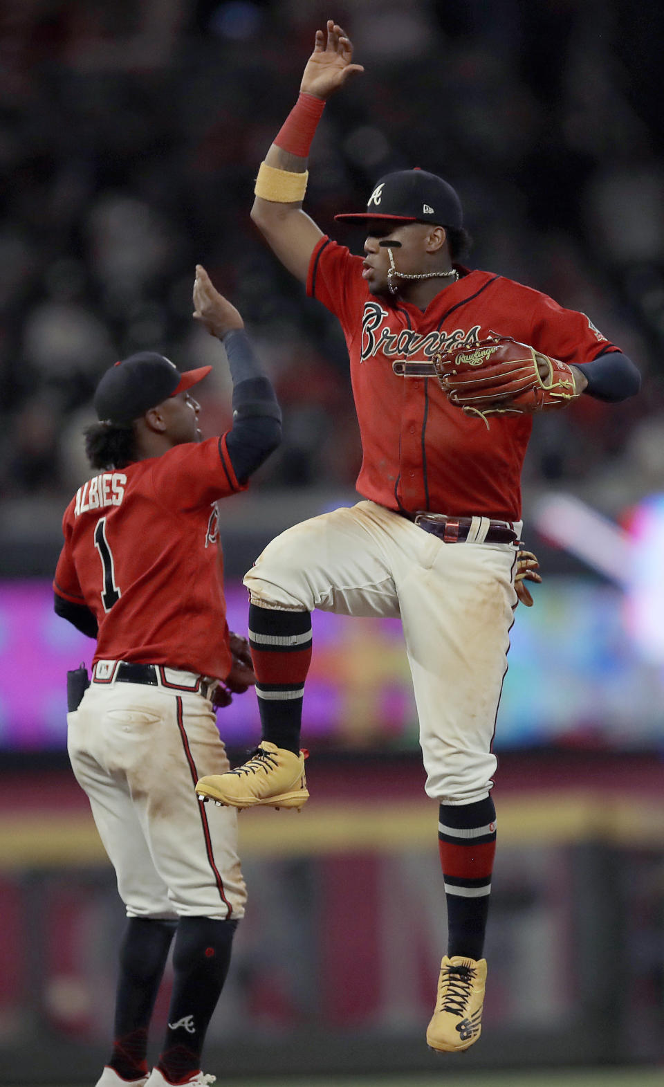Atlanta Braves' Ronald Acuna Jr., right, celebrates with Ozzie Albies (1) at the end of a baseball game against the St. Louis Cardinals, Friday, June 18, 2021, in Atlanta. (AP Photo/Ben Margot)