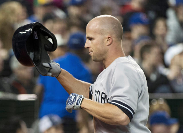 New York Yankees left fielder Brett Gardner crosses home plate after hitting a two-run home run against the Toronto Blue Jays during the fourth inning of a baseball game in Toronto on Sunday, April 6, 2014. (AP Photo/The Canadian Press, Nathan Denette)