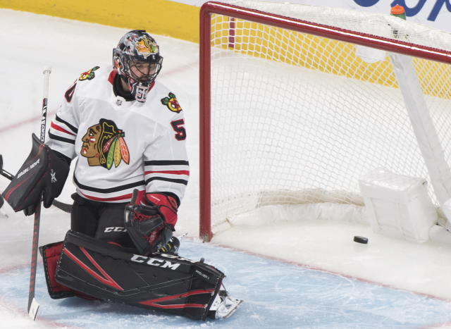 Chicago Blackhawks goaltender Corey Crawford gives up a goal to Montreal Canadiens' Phillip Danault during the second period of an NHL hockey game Wednesday, Jan. 15, 2020, in Montreal. (Graham Hughes/The Canadian Press via AP)