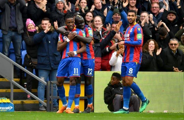 Wilfried Zaha (left) was on the scoresheet as Palace thrashed Leicester