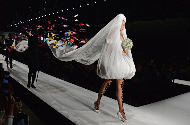 MILAN, ITALY - SEPTEMBER 20: Gigi Hadid walks the runway during the Moschino SS19 Show during Milan Fashion Week on September 20, 2018 in Milan, Italy. (Photo by David M. Benett/Dave Benett/Getty Images)
