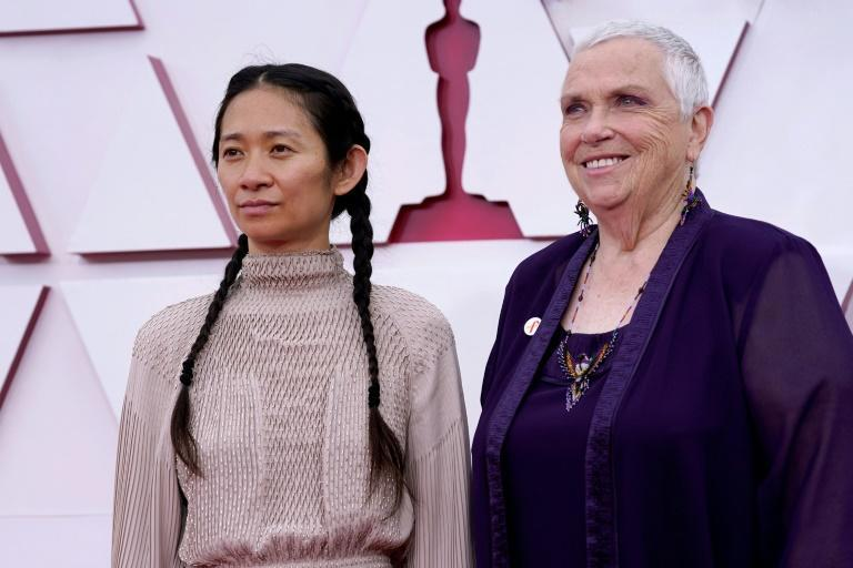 """""""Nomadland"""" starred multiple real-life nomads who played themeslves, including Charlene Swankie (R) who arrived at the Oscars with director Chloe Zhao (L)"""