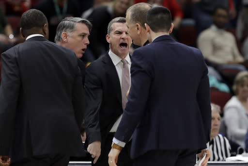 Maryland head coach Mark Turgeon, center, argues a call during the second half of an NCAA college basketball game against the Nebraska in the second round of the Big Ten Conference tournament, Thursday, March 14, 2019, in Chicago. The Nebraska won 69-61. (AP Photo/Nam Y. Huh)