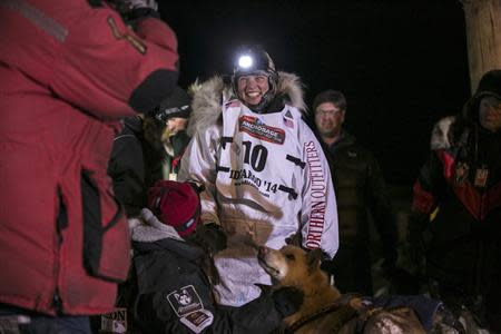 Second place finisher for the third year in a row, Aliy Zirkle talks with reporters after completing the Iditarod dog sled race in Nome, Alaska, March 11, 2014. REUTERS/Nathaniel Wilder