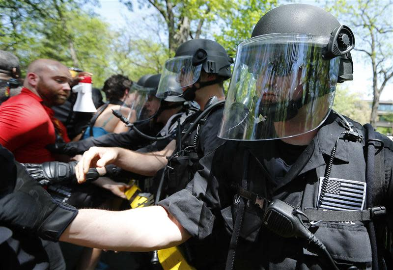 Demonstrators clash with police during a protest at the McDonald's headquarters in Oak Brook