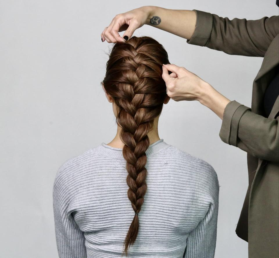 <p>To give the look a certain je ne sais quoi - in other words, make the braids look fuller with more texture - use your fingertips to gently tug at the plaits.</p>