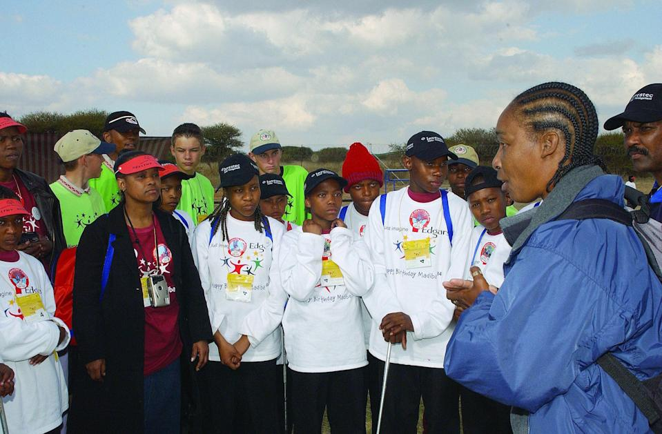 "<div class=""caption""> Claiborne (far right) speaks with student athletes in South Africa. </div> <cite class=""credit"">Julian Cole Photography / Courtesy of Special Olympics</cite>"