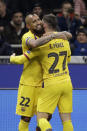Barcelona's Carles Perez, right, celebrates with his teammate Barcelona's Arturo Vidal after scoring his side's opening goal during the Champions League, group F soccer match between Inter Milan and F.C. Barcelona, at the San Siro stadium in Milan, Italy, Tuesday, Dec. 10, 2019. (AP Photo/Luca Bruno)