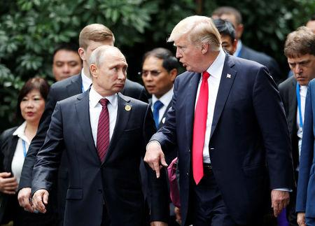 U.S. President Donald Trump and Russia's President Vladimir Putin talk during the family photo session at the APEC Summit in Danang, Vietnam November 11, 2017. REUTERS/Jorge Silva