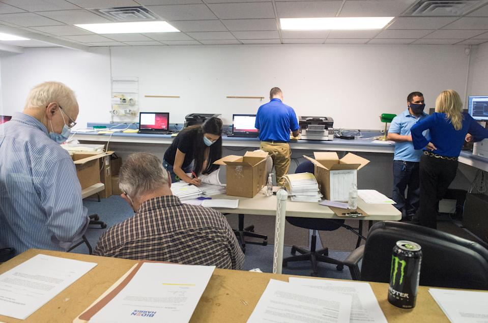 Republican observers watch election officials counting absentee ballots during the Georgia presidential election recount  (AP)