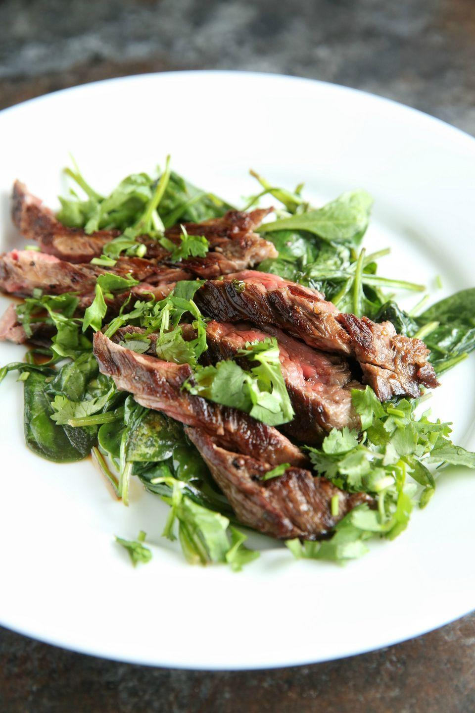 """<p>Forget A1—the herby sauce on this steak is the bomb.</p><p>Get the recipe from <a href=""""https://www.delish.com/cooking/recipe-ideas/recipes/a47387/ginger-garlic-flank-steak-recipe/"""" rel=""""nofollow noopener"""" target=""""_blank"""" data-ylk=""""slk:Delish"""" class=""""link rapid-noclick-resp"""">Delish</a>. </p>"""