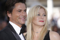 Actor Rob Lowe, left, and his wife Sheryl Lowe arrive for the screening of The Tree of Life at the 64th international film festival, in Cannes, southern France, Monday, May 16, 2011. (AP Photo/Joel Ryan)