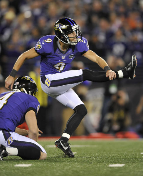 Baltimore Ravens kicker Justin Tucker watches his game-winning field goal in the final moments of an NFL football game against the New England Patriots in Baltimore, Sunday, Sept. 23, 2012. Baltimore won 31-30. (AP Photo/Gail Burton)