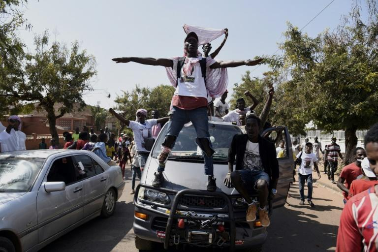 Joy: Supporters of newly-elected President Umaro Sissoco Embalo take to the streets (AFP Photo/SEYLLOU)