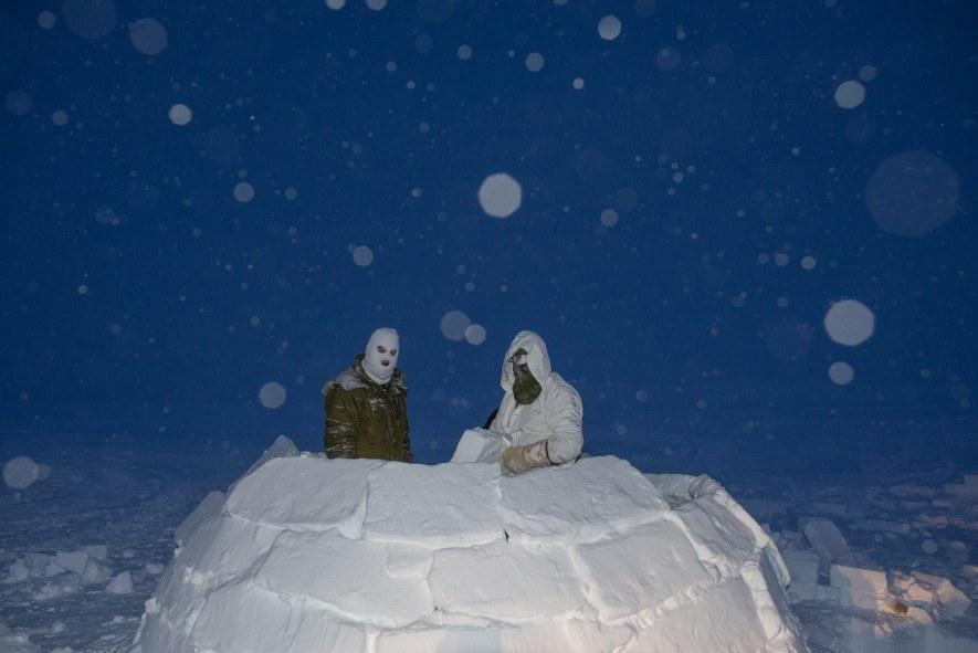 Canadian soldiers build an igloo during the high Arctic phase of their training to become Arctic operations advisors. In this part of the programme, they learn to travel, survive, and build shelters when they reach the high Arctic. (National Geographic/Pascal Maitre)