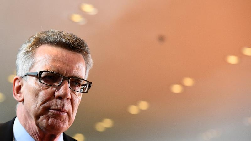 German Interior Minister Thomas de Maiziere arrives for the weekly cabinet meeting at the Chancellery in Berlin on November 18, 2015