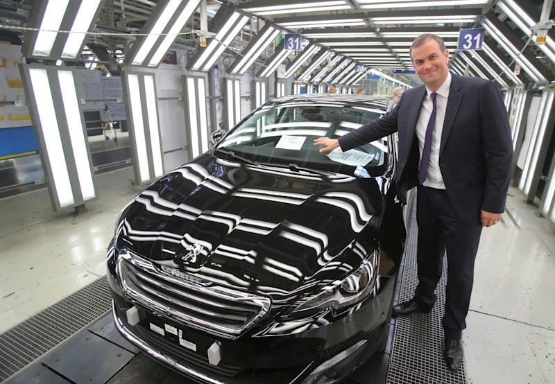 The Aug. 27, 2013 file photo shows the head of French carmaker Peugoet, Maxime Picat, pointing to the new 308 during an interview with the Associated Press on the quality control line at the Peugeot plant in Sochaux, eastern France. The car will be presented at the Frankfurt Auto Show running through Sept. 22, 2013. The money-losing French automaker PSA Peugeot Citroen needs this new model to be a winner in the brutal competition among mass-market carmakers in Europe. (AP Photo/Michel Euler)