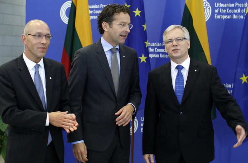 Lithuania's Minister of Finance Rimantas Sadzius, center, greets President of the Eurogroup Jeroen Dijsselbloem, center, and European Central Bank Executive Board member Joerg Asmussen, left, prior to the Informal Meeting of Ministers for Economic and Financial Affairs (ECOFIN) at the National Art Gallery in Vilnius, Lithuania, Friday, Sept. 13, 2013. Ministers from the 17 European Union countries that use the euro currency met Friday in Vilnius, Lithuania, to discuss the establishment of a joint authority to restructure or unwind bust banks, and how to finance those interventions. (AP Photo/Mindaugas Kulbis)