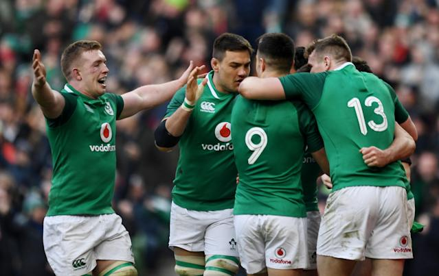 Rugby Union - Six Nations Championship - Ireland vs Wales - Aviva Stadium, Dublin, Republic of Ireland - February 24, 2018 Ireland's Cian Healy (hidden) celebrates with team mates after scoring their fourth try REUTERS/Clodagh Kilcoyne