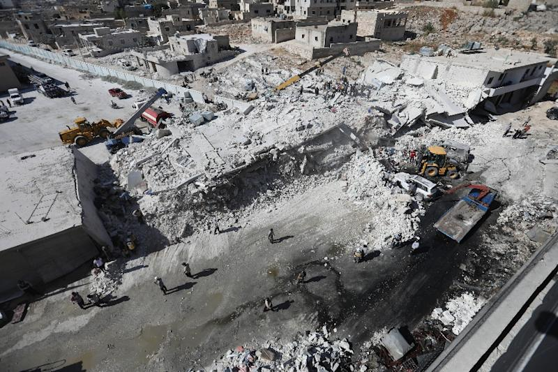 Destroyed buildings are seen on August 12, 2018 following an explosion that reportedly killed 12 people at an arms depot in a residential area in the Syrian town of Sarmada, Idlib province (AFP Photo/OMAR HAJ KADOUR)