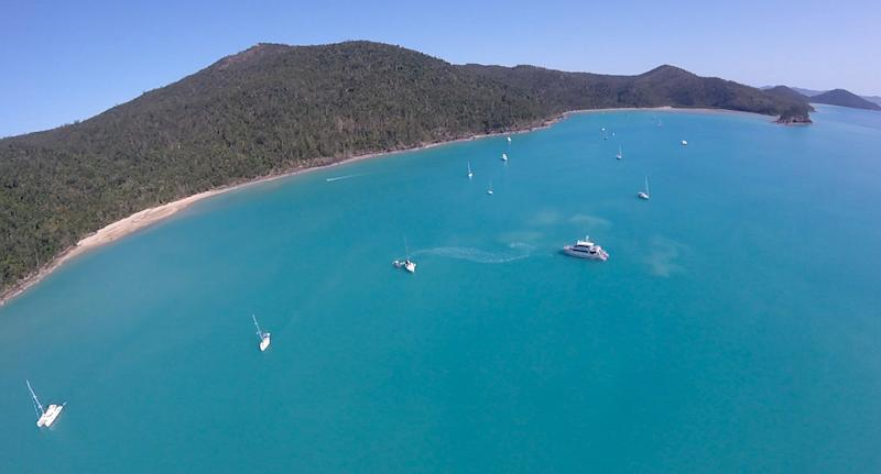 An areal shot of a CQ Rescue team attending to 2018 shark attack on the Whitsundays