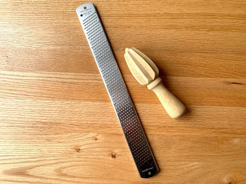 A Microplane brand grater and citrus reamer.